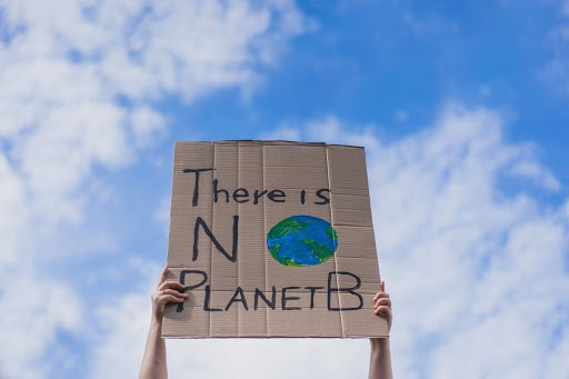 Image of a placard against global warming.