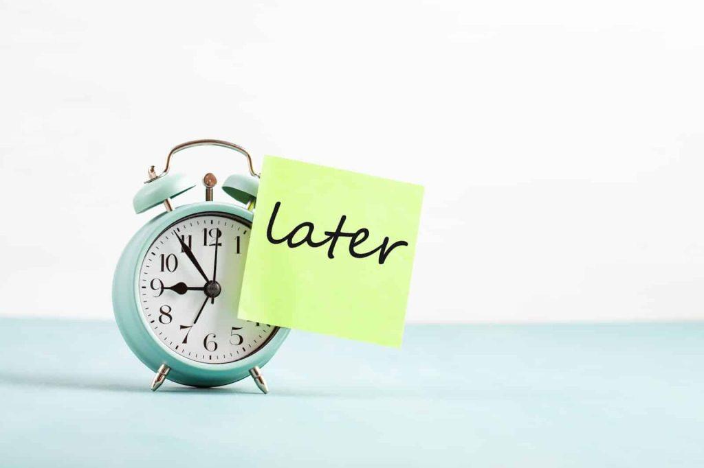 Procrastination - Time clock saying later